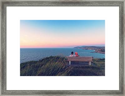couple on bench vith view of Sopelana coast Framed Print by Mikel Martinez de Osaba