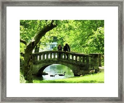 Couple On Bridge In Park Framed Print by Susan Savad