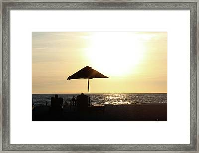 Couple On The Beach At Sunset Framed Print