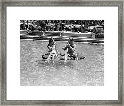 Couple Relaxing In Pool, C.1930-40s Framed Print by H. Armstrong Roberts/ClassicStock