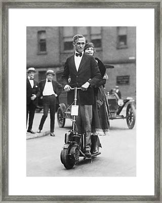 Couple Riding An Autoped Framed Print by Underwood Archives