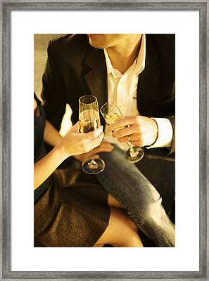 Couple Sitting, Clinking Champagne Framed Print by Gillham Studios