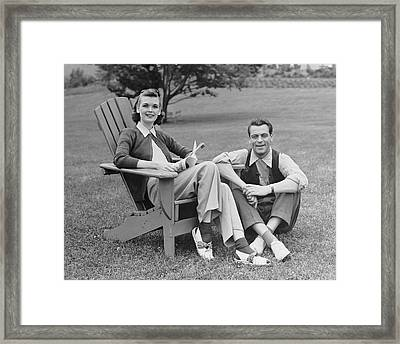Couple Sitting Outdoors Framed Print by George Marks
