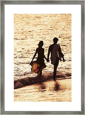 Couple Wading In Ocean Framed Print by Larry Dale Gordon - Printscapes
