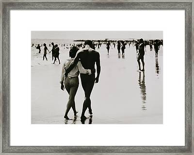 Couple Walking In The Water At Coney Island Framed Print