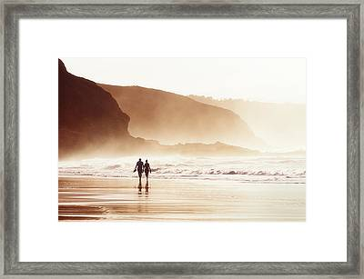 Couple Walking On Beach With Fog Framed Print