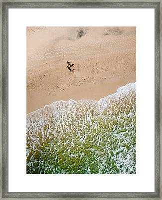 Couple Walking On Tallow Beach Framed Print
