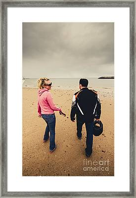 Couple Walking Together On Overcast Beach Framed Print