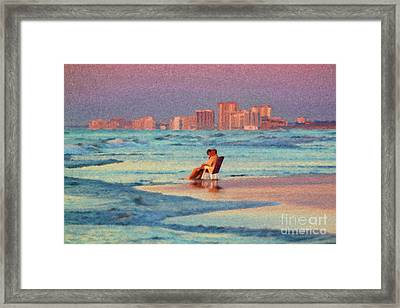 Couple Watching The Sunset Framed Print by Jeff Breiman