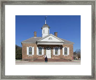 Courthouse Gossip Framed Print