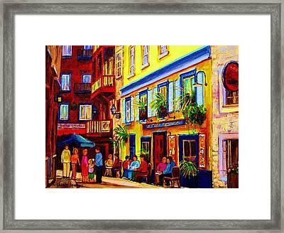 Courtyard Cafes Framed Print by Carole Spandau