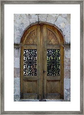 Courtyard Door In Villereal Framed Print