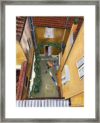 Courtyard In Milan Framed Print