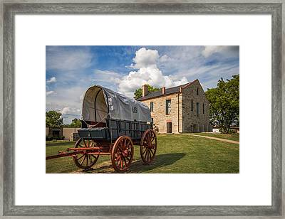 Covered Wagon And Stone Building Framed Print by James Barber