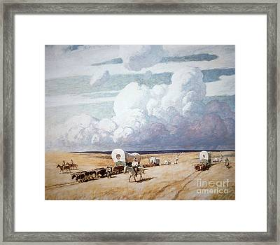 Covered Wagons Heading West Framed Print by Newell Convers Wyeth