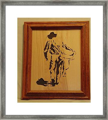 Cowboy And Saddle Framed Print by Russell Ellingsworth