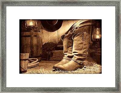 Cowboy Boots In A Ranch Barn Framed Print