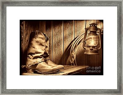 Cowboy Boots In Old Barn Framed Print