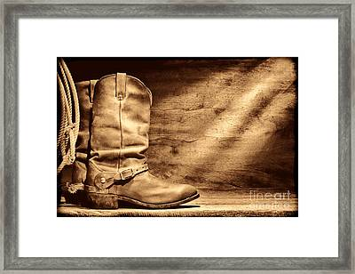 Cowboy Boots On Wood Floor Framed Print