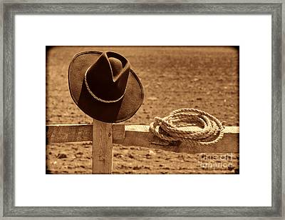 Cowboy Hat And Rope On A Fence Framed Print