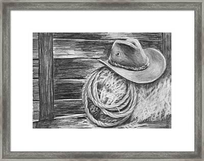 Cowboy Hat In A Barn Framed Print by Nolan Clark