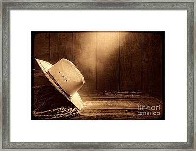 Cowboy Hat In The Old Barn Framed Print