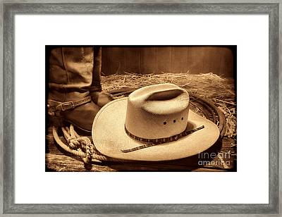Cowboy Hat On Barn Floor Framed Print