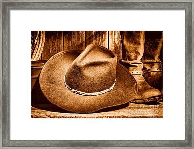 Cowboy Hat On Floor - Sepia Framed Print