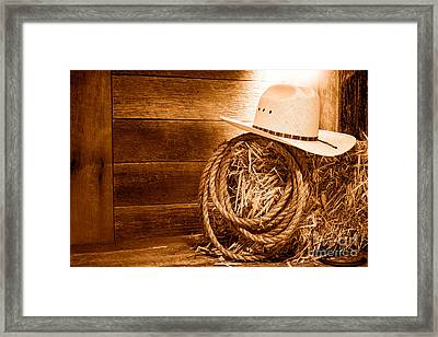 Cowboy Hat On Hay Bale - Sepia Framed Print by Olivier Le Queinec
