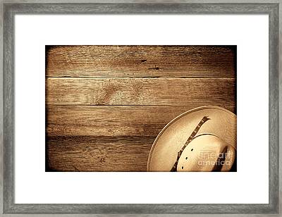 Cowboy Hat On Wood Table Framed Print