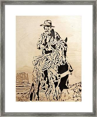 Cowboy On Bluff Framed Print by Kris Martinson