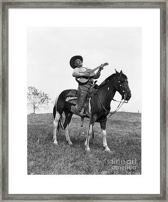 Cowboy On Horse Singing And Playing Framed Print by H. Armstrong Roberts/ClassicStock