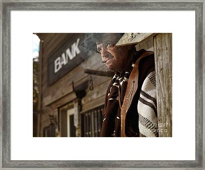 Cowboy Smoking A Cigar Outside Of A Bank Building Framed Print by Oleksiy Maksymenko