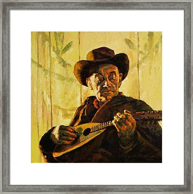 Cowboy With Mandolin Framed Print by John Lautermilch