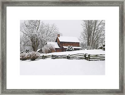 Cozy Snow Cabin Framed Print by J K York