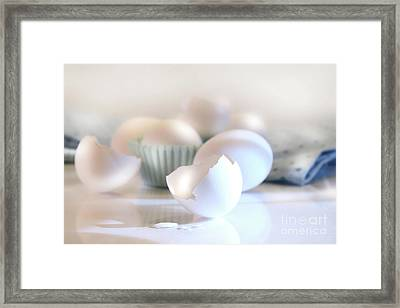 Cracked Egg Shell On The Counter Framed Print by Sandra Cunningham