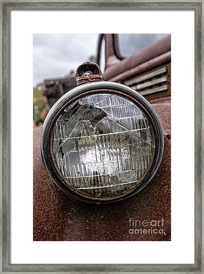 Cracked Headlight On An Old Truck Framed Print by Edward Fielding