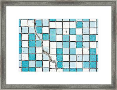 Cracked Tiled Surface Framed Print by Tom Gowanlock