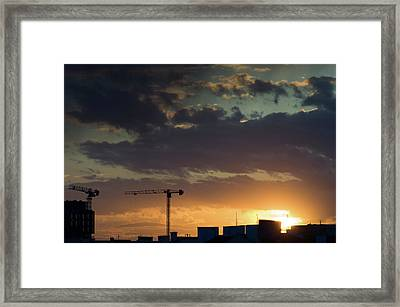 Cranes And Rooftops Framed Print by John Janicki