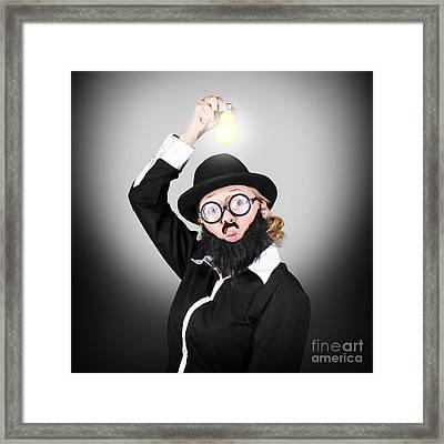 Creative Business Man Holding Light Bulb Framed Print by Jorgo Photography - Wall Art Gallery