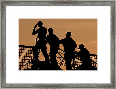 Crewmen Salute The American Flag Framed Print