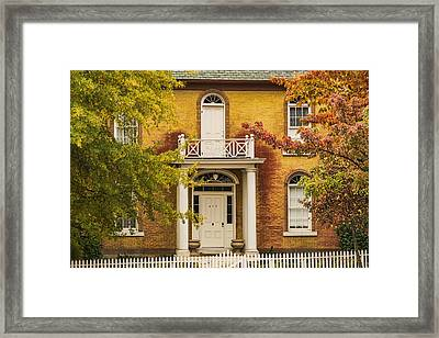 Crooked White Fence Framed Print
