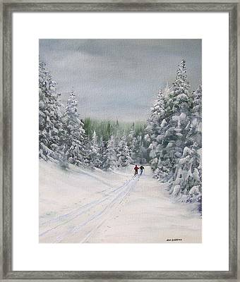 Cross Country Skiers Framed Print by Ken Ahlering