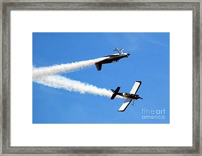 Crossing Paths Framed Print by Larry Keahey