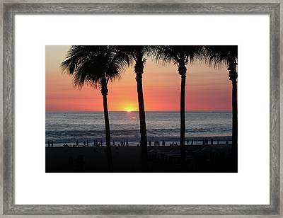 Crowd At Sunset Framed Print