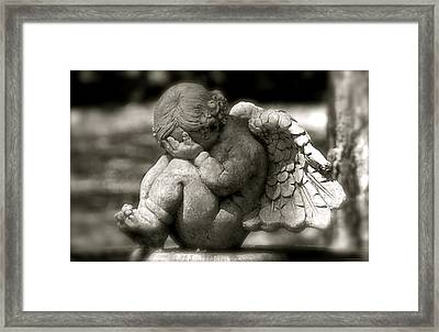 Crying Cherub Framed Print by Kathy Gibbons