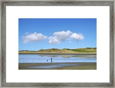 Culleenamore, Strandhill, Sligo - A Man And A Dog Cycle Over The Water To The Dunes On A Sunny Day Framed Print
