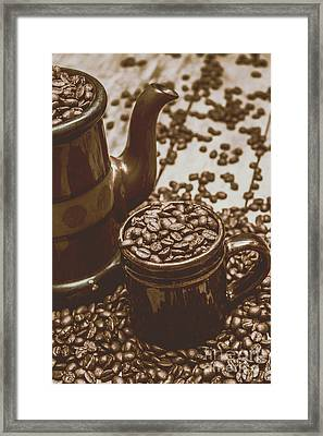 Cup And Teapot Filled With Roasted Coffee Beans Framed Print