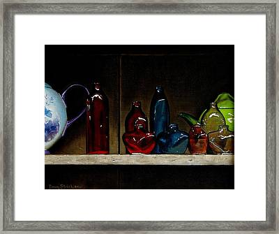 Cupboard Bottles Framed Print by Doug Strickland