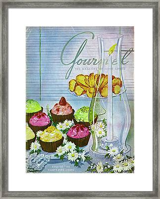 Cupcakes And Gaufrettes Beside A Candle Framed Print by Henry Stahlhut